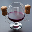 Two wine cork are hanging on  glass of wine — ストック写真