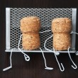 Two wine corks are sitting on bench — Stock Photo