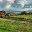 Old ranch on  green field HDR - Foto Stock