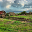Stock Photo: old ranch on green field hdr