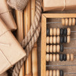 Pile parcel wrapped and abacus — Stock Photo