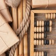 Stock Photo: Pile parcel wrapped and abacus