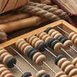 Pile parcel wrapped with brown kraft paper and abacus — Stock Photo #5778696