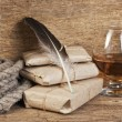 Quill in the inkwell and glass of wine — Stock Photo