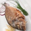Dish of fried fish with onions — Stock Photo