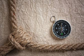 Compass, old paper and rope, still-life — Stock Photo