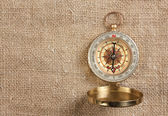 Compass on old canvas background — Stock Photo