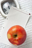 Apple and a note on floor scales — Stock Photo