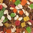 A mixture of nuts and dried fruit pieces - Stock Photo
