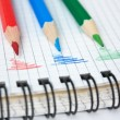Red, green, and blue pencil on notepad — Stock Photo #5931556