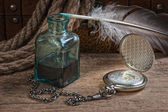 Old pocket watch and inkwell — Stock Photo