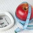 Apple and measuring tape on the floor scales — Stock Photo