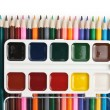 Colored pencils and watercolor paints — Stock Photo