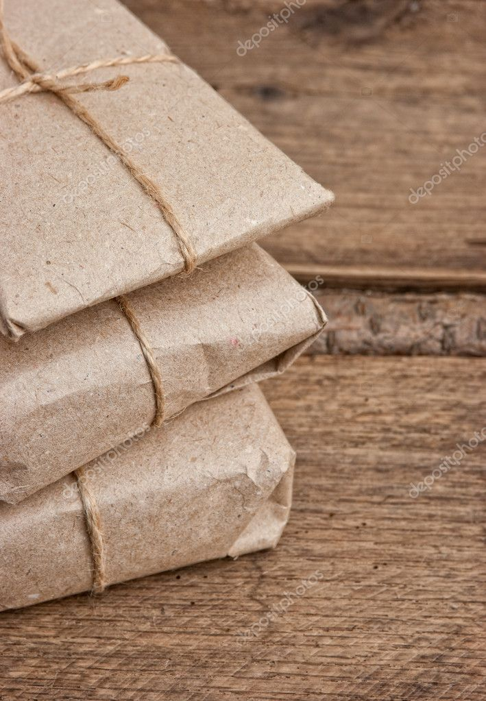 Pile parcel wrapped with brown kraft paper and tied with twine  Stock Photo #6205903