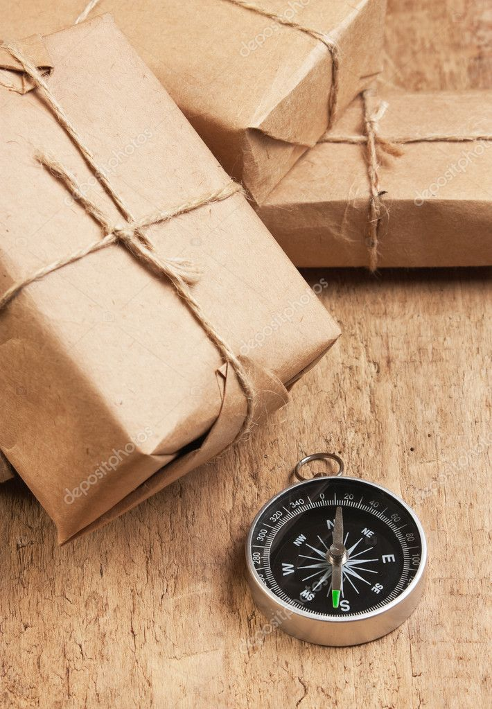 Pile parcel wrapped with brown kraft paper and tied with twine — Stock Photo #6206214