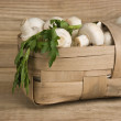 Basket with mushrooms on wooden background — Stockfoto