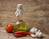 Glass bottle with spices and vegetables — Stock Photo