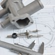 Photo: Automotive parts and drawing