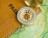 Compass and passport on the map — Stock Photo