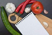 Notebook for cooking recipes and vegetables — Stock fotografie