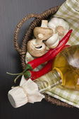 Vegetables and basket with bottle of vinegar — Stock Photo