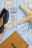Passport and sunglasses on map — Stock Photo
