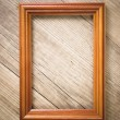Old picture frame on a wooden background — Stock Photo