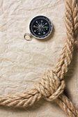 Compass, old paper and rope — Stock Photo