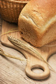 Wheat bread on a wooden table — Stock Photo