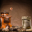 Royalty-Free Stock Photo: Mill and bag with coffee beans