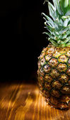 Copyspace view of ananas on wooden board — Stock Photo