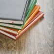 Stock Photo: Notebooks on wooden board