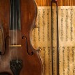 Violin and fiddlestick on note - Stock Photo