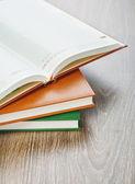 Three notebooks on wooden background — Stock Photo
