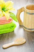 Towels flower hairbrush and mug — Stok fotoğraf