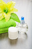 Transparent bottle towel flower and cotton pads — Stock Photo