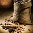 Small coffee sack vith cinnamon and copy space - Stock Photo