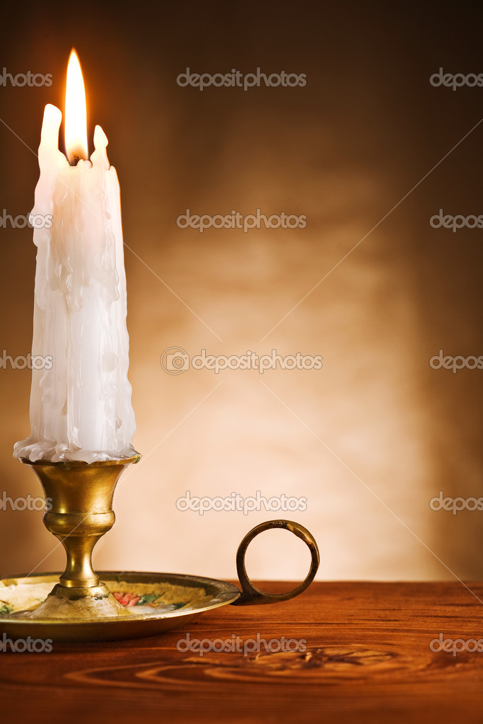 Copy space ablaze candle in old candlestick — Stock Photo #5843709