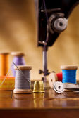 Small sewing wooden bobbin with other items — Stock Photo