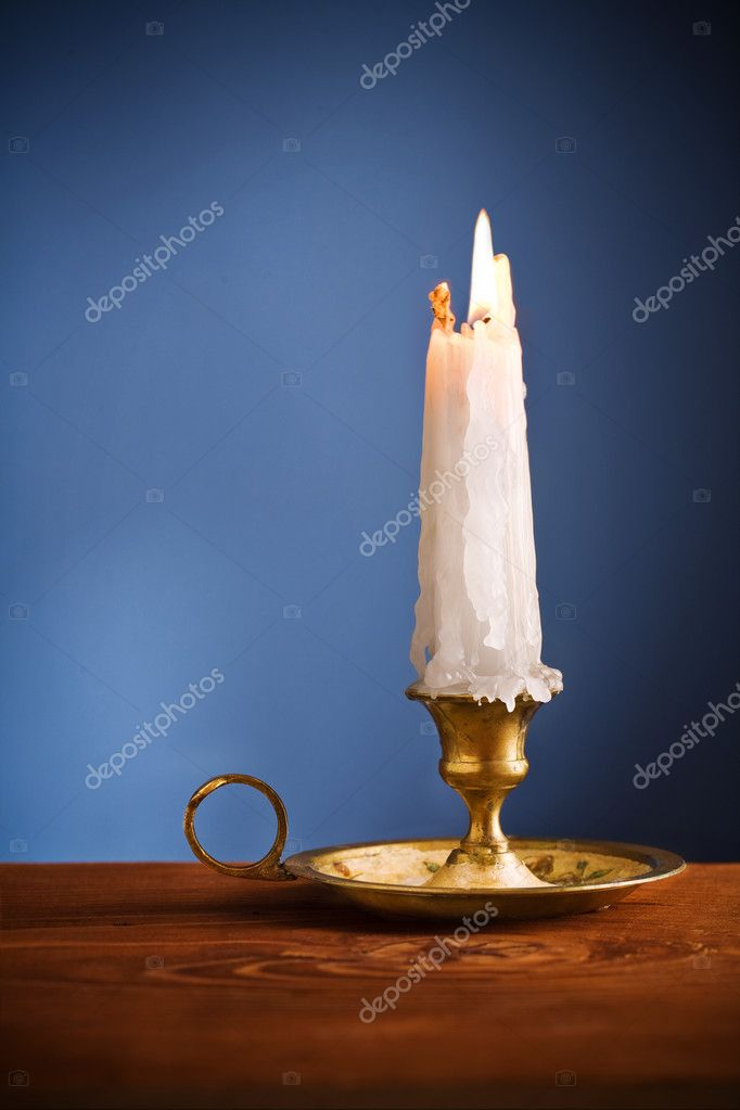 Copy space candle on blue background  Foto de Stock   #5981989