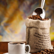 Cup with coffee and sack — Stock Photo