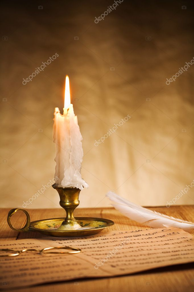 Burning candle and music sheet — Stock Photo #6664538