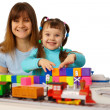 Young mother and daughter playing with toys — Stock Photo