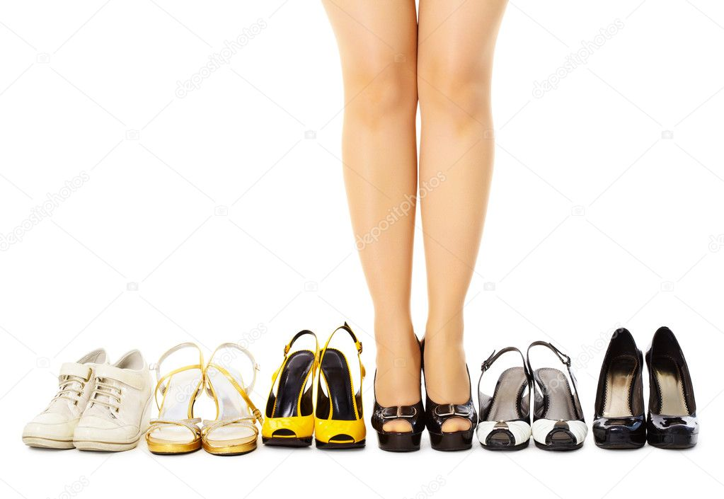 Large selection of women's shoes for different weather, isolated on white background — Stock Photo #5444357