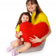 mom and daughter with a toy heart in hands — Stock Photo