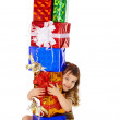 Little girl hugs birthday gifts — Stock Photo