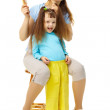 Cheerful mum and daughter do a hairdress - Stock Photo