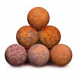 Ten rusty iron cannon balls on white background — Stock Photo