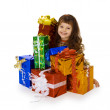 Happy child and big heap of gifts — Stock Photo #5475739