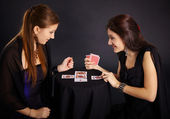 Two girls friends engaged in fortune-telling cards — Stock Photo
